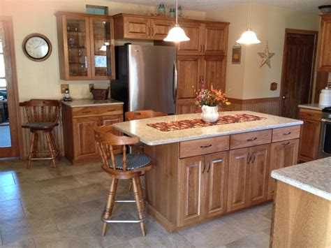 cabinet appliances with brown stained wooden hickory custom calico hickory kitchen stained in medium brown