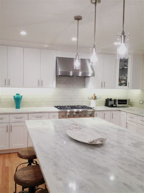 How To Install A Glass Tile Backsplash In The Kitchen by Elegant Quartzite Countertop Kitchenartistic Stone Kitchen