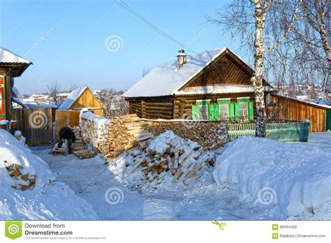 wooden russian house in winter covered with snow stock russian village visim in winter ural region russia stock