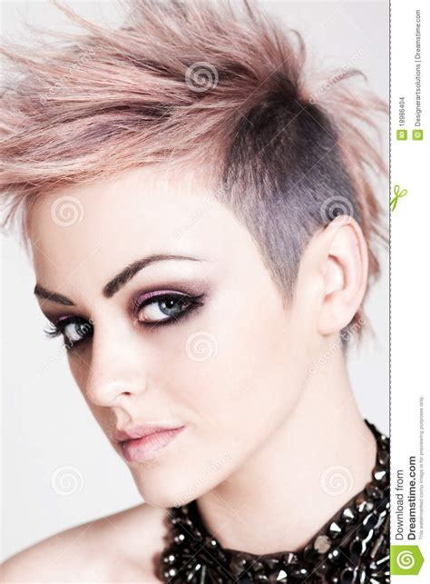 what hairstyle are women most attracted to attractive young woman with a punk hairstyle stock images