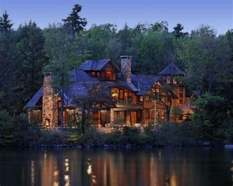 a log cabin on a lake house stuff