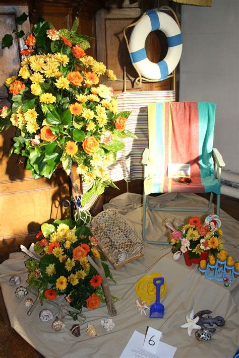 flower arrangement pictures with theme all saints church renwick seaside themed flower festival arrangement yellow orange gerbera