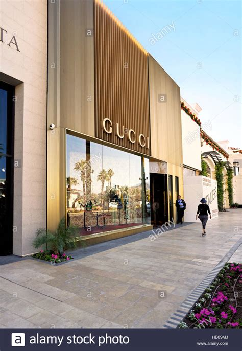 sunnc mirage awning a security guard and woman walking in front of gucci an