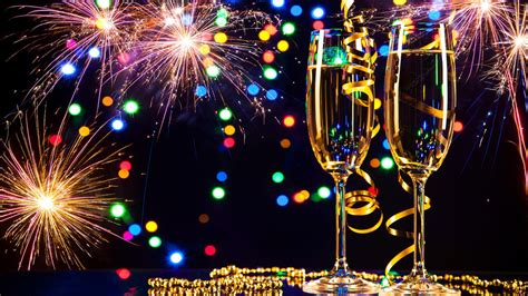 happy new year 2017 glasses of chagne and fireworks