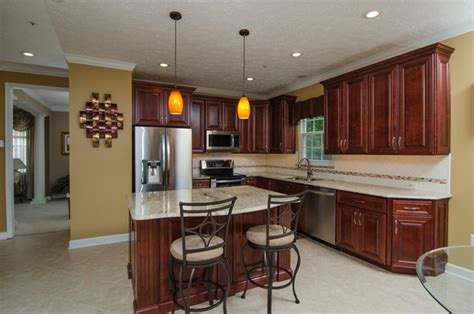 White Kitchen Island With Black Granite Top golden ivory granite with cherry cabinets traditional