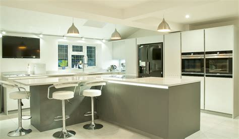 l shaped island kitchen satin lacquer in lava grey and light grey with quartz