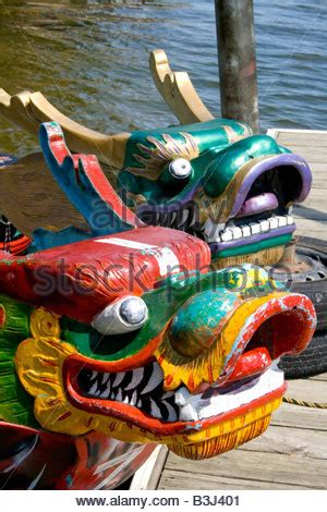 dragon boat festival 2017 lake phalen fierce asian dragon heads on bow of racing boats moored at