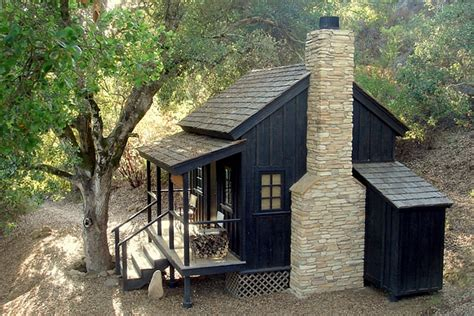 building a small cabin in the woods small bunkie with front porch and stone fireplace