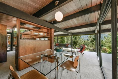 mid century modern home clad with wood of various shades