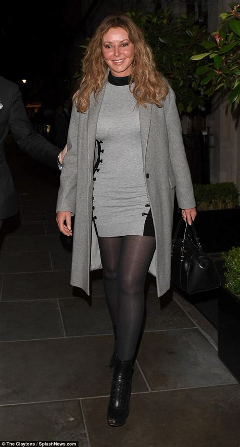 carol vorderman cuts  casual figure   grey dress