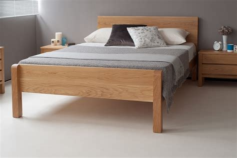 futon mattresses uk tibet contemporary wooden bed with footboard from natural