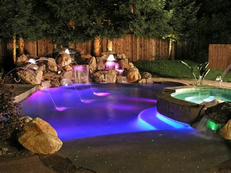 beautiful outdoor lighting around pool and landscape ideas he s out by the pool which is lit with led lights