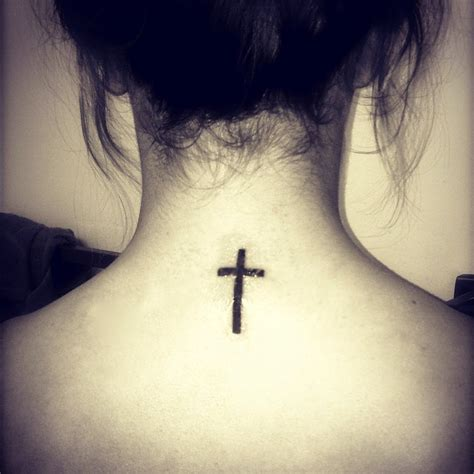 simple cross tattoo on back cross on back tattoos piercings