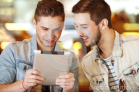 hipster male student showing thumb group stock photo young hipster guy sitting in a cafe chatting and drinking