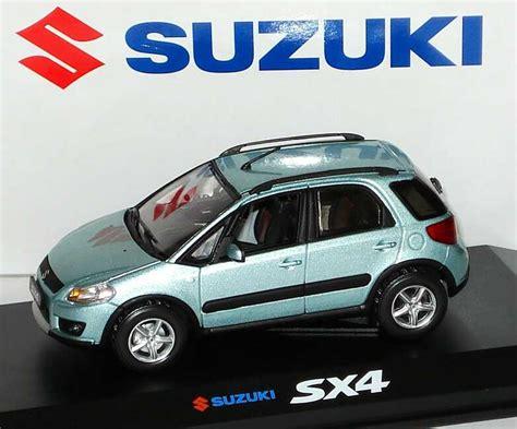 Suzuki Light Blue 1 43 Suzuki Sx4 Light Blue Met Werbemodell Norev