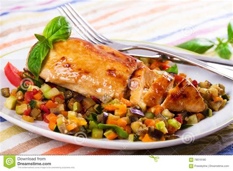 fried chicken breast with sauteed vegetables stock photo image 78019180