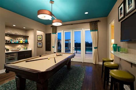 modern billiard room with turquoise ceiling