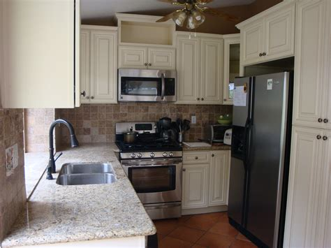 venetian gold granite with white cabinets venetian gold granite with antique white cabinets