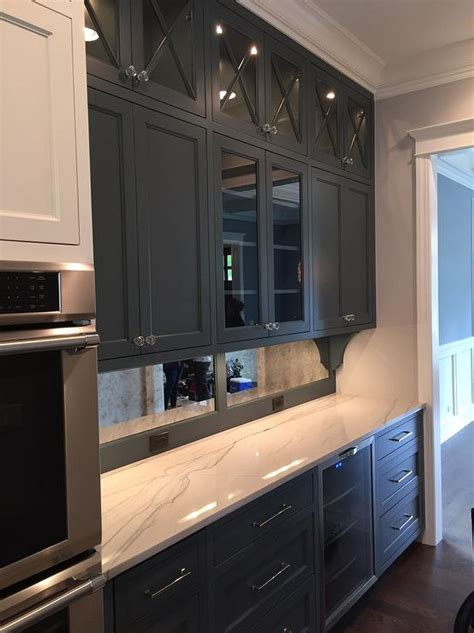 mirrored glass kitchen cabinets butler pantry with antiqued mirrored backsplash