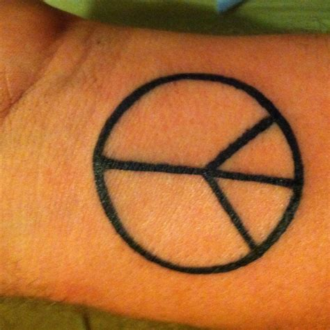 peace sign tattoo on wrist 38 best and peace tattoos images on