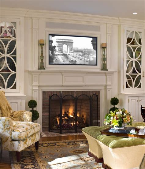 living room with fire place placing a tv over your fireplace a do or a don t