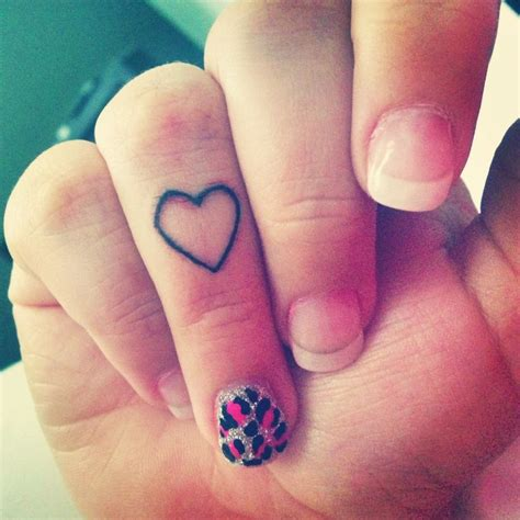heartbeat tattoo on finger heart tattoo on finger designs ideas and meaning