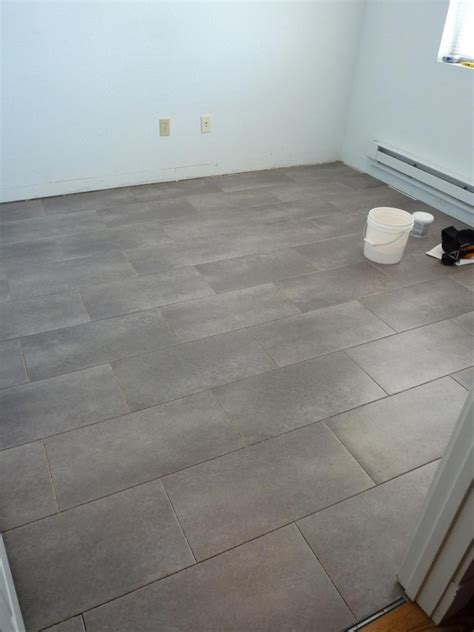 kitchen floor idea trafficmaster ceramica 12 in x 24 in coastal grey vinyl tile flooring 30