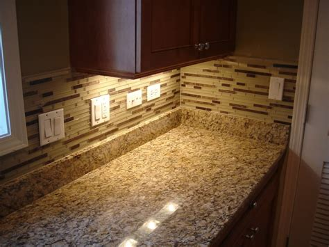 granite backsplash or tile cozy countertop design with giallo ornamental granite mosaic tile backsplash with cabinet