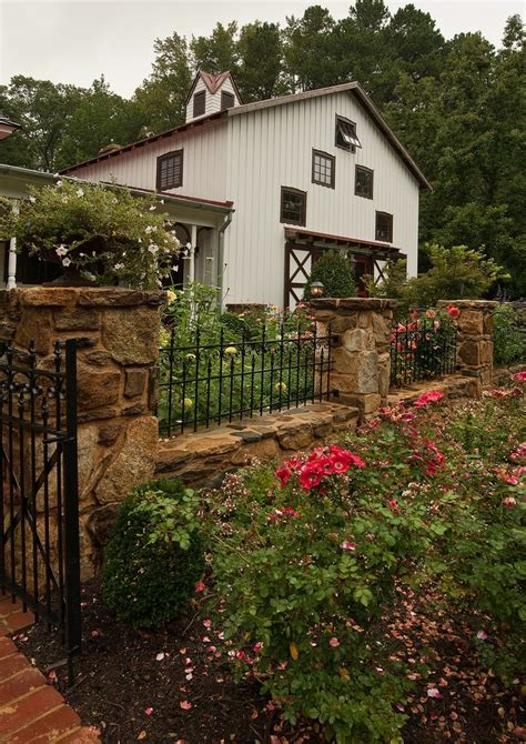 Wrought iron fencing landscape traditional with square columns locking wall