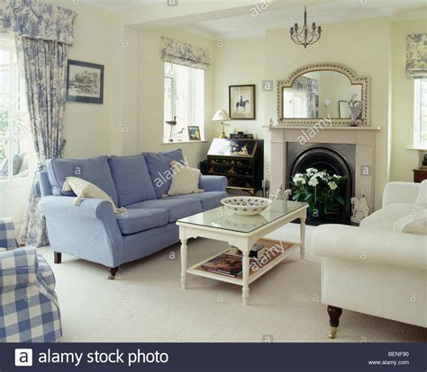 cream living rooms blue and cream sofas on either side of fireplace in cream