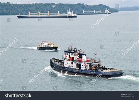 tugboat pilot tugboat and pilot boat in the panama channel with two