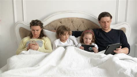 very young kids bedroom with dad video search nice family opening christmas presents while sitting on