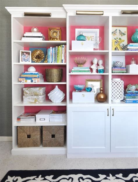 combine two billy bookcases with a besta base cabinet and shelving unit from ikea to provide
