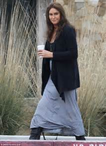 caitlyn jenner looks stylish on coffee run in boots daily mail online