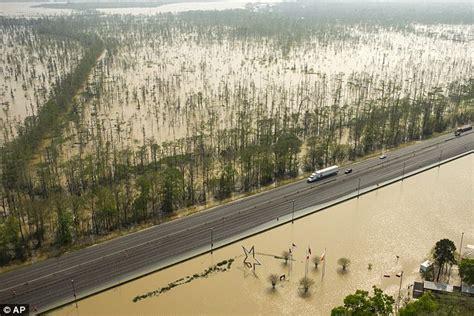 boat building officials texas louisiana floods bring calcasieu cemetery caskets up from