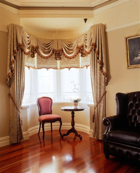 blinds and matching curtains bay window with swags and tails and matching drapes and