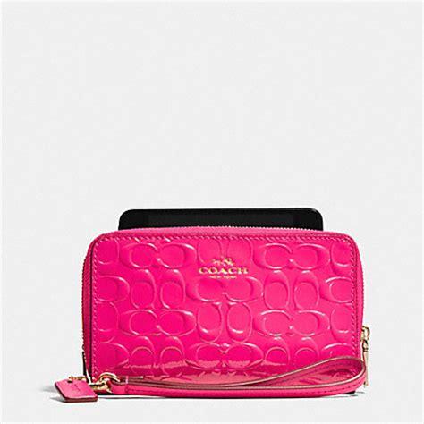 light pink coach wallet double zip phone wallet in signature debossed patent