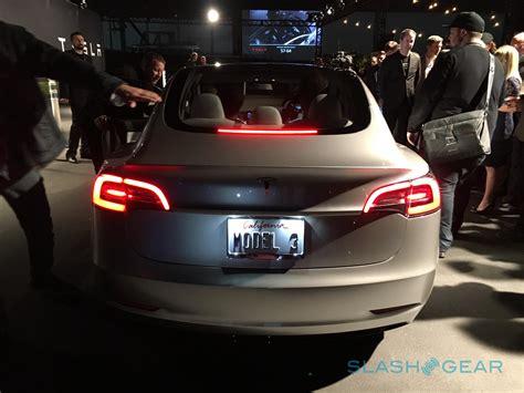 tesla model 3 back elon musk feeds tesla model 3 with new car details