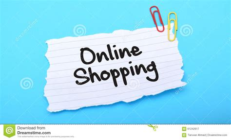 background online shop online shopping written on paper with blue background
