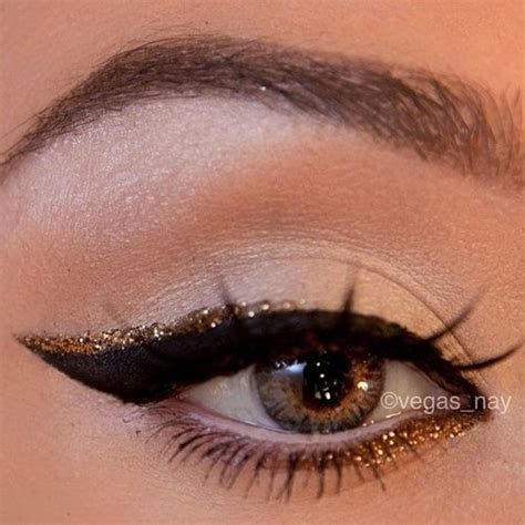 eyeliner tutorial top and bottom thick black cat eye winged eye liner with a touch of gold