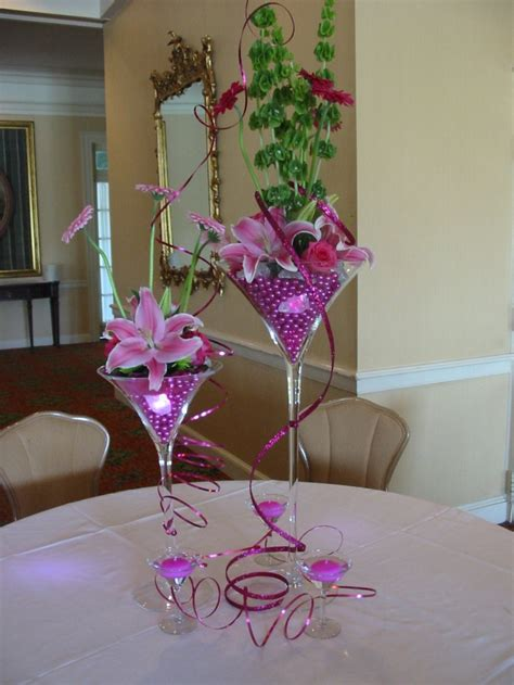 martini glass centerpiece centerpiece using martini glasses filled with pink pearls small lights and flowers accented