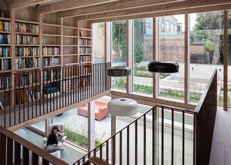 home design courses london a double height living room and a mezzanine library