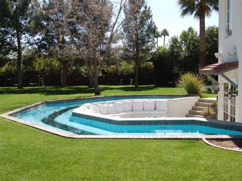 one end of pool with lazy river backyard oasis backyard lazy river when i win the lotto pinterest