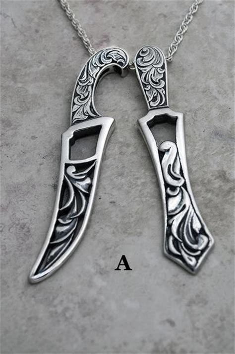 carved sculpted and engraved larger khanda and kirpan