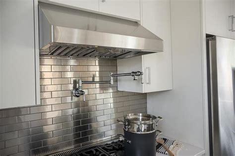 kitchen  stainless steel mini brick tile backsplash transitional kitchen