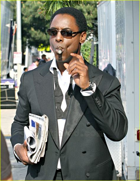 full sized photo of 04 isaiah washington smoking cigar