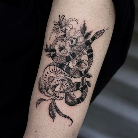 blackwork tattoo meaning snake flowers oozytattoo blackwork