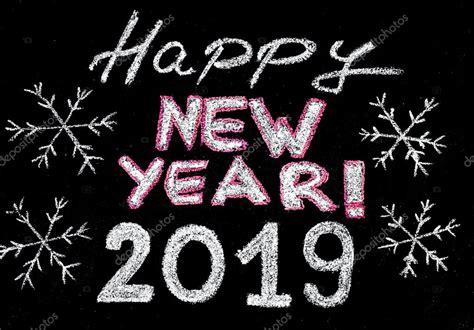 new year 2019 happy new year 2019 writing with chalk on blackboard