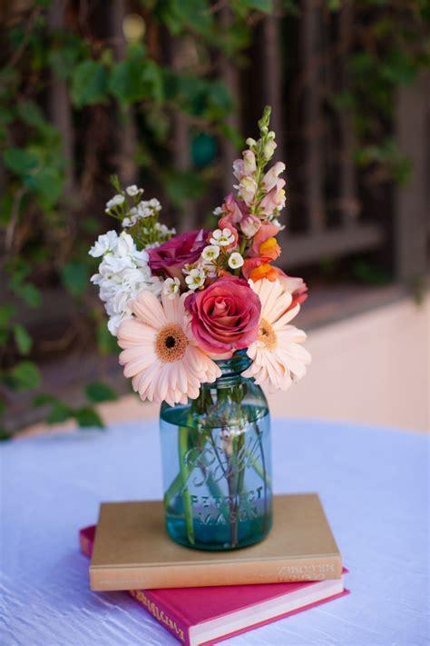 wedding flowers cocktail hour table decor mason jar on