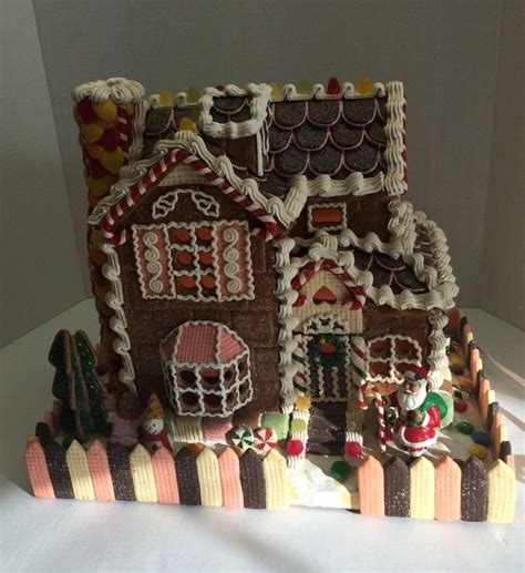 christmas on pinterest gingerbread houses garlands and vintage traditions lighted gingerbread house with santa